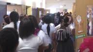 Students Walking In Catholic High School Hall