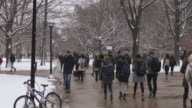 Students walking through snowy college campus