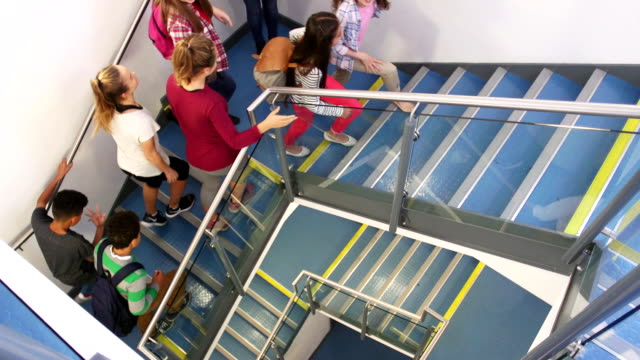 Students Walking up School Staircase