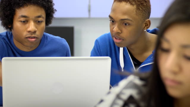 Students with Laptop Computer in Classroom