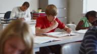 MS PAN Students (8-13) working on homework in classroom / Edmonds, Washington, USA