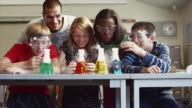 MS Students (8-13) working on science project in classroom / Edmonds, Washington, USA