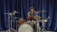 ZO WS Studio portrait of teenage (16-17) drummer