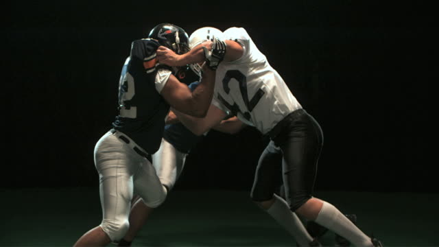 SLO MO MS Studio shot of American football players in action