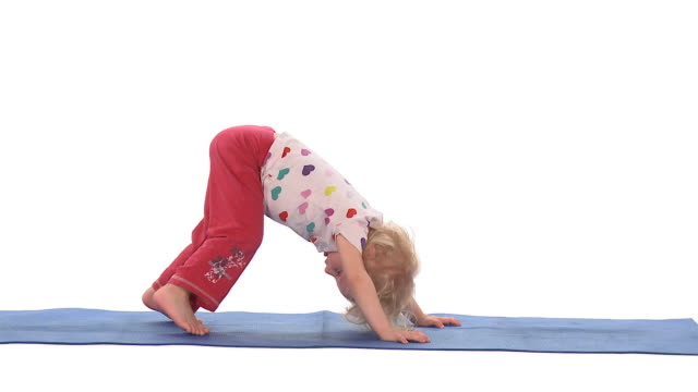 WS Studio shot of girl (2-3) yoga downward facing dog pose on exercise mat