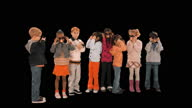 WS, Studio shot of happy elementary school students (6-7) with Groucho Marx masks