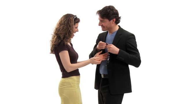 MS Studio shot of loving couple, man giving woman necklace, Vrhnika, Slovenia