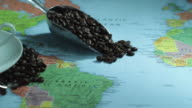 CU PAN Studio shot of map of Africa and South America with cup and coffee beans