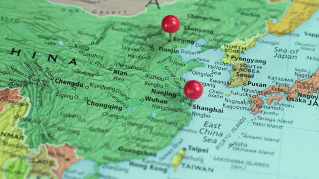 CU SELECTIVE FOCUS Studio shot of map of Asia with pins