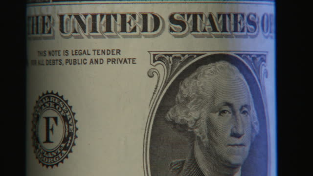 ECU, TD, Studio shot of One Dollar bill turning