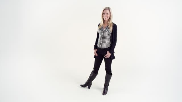 WS Studio shot of smiling young woman