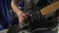 CU TU Studio shot of teenage boy (16-17) playing electric guitar