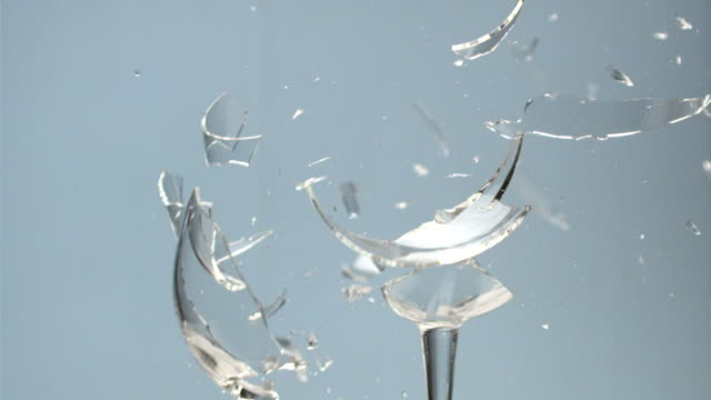 SLO MO CU Studio shot of wine glass exploding