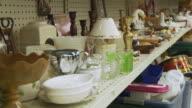 MS POV Stuff on shelves in thrift store / Morris, Illinois, USA