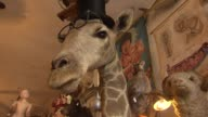 Stuffed giraffe at Woolly Mammoth Antiques and Oddities on Sept 3 2014 in Chicago