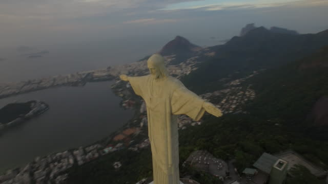 Stunning aerial view of Christ the Redeemer at sunrise in Rio De Janeiro Brazil