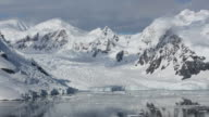 Stunning coastal scenery beneath Mount Walker in Paradise Bay off Graham Land on the Antarctic Peninsular. the Peninsular is one of the most rapidly warming places on the planet.