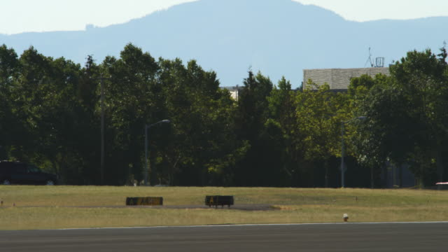 Stunt jet taxiing right to left through frame at an air show