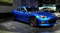 WS Subaru BRZ sports car revolving on turntable / CU rear end passing through frame then front end passing through frame NARRATOR ON SOUNDTRACK talks...