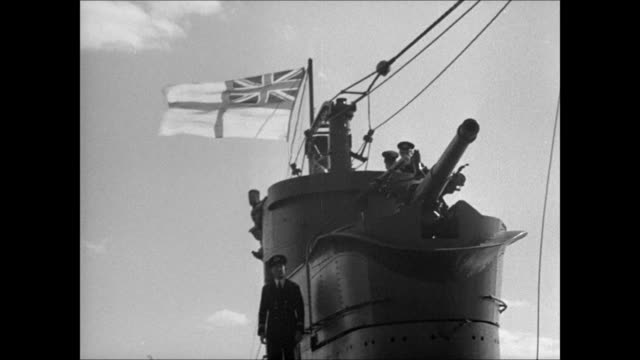 WS Submarine above water MS Man steering sailboat watching WS British Royal Navy flag rising on submarine deck VS Norwegian refugees cheering WS...