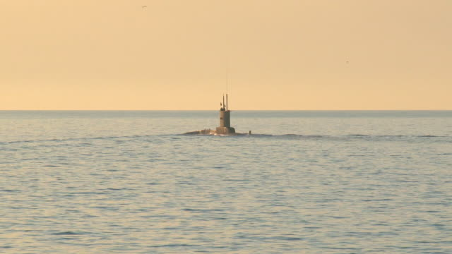 submarine in the open sea at sunset