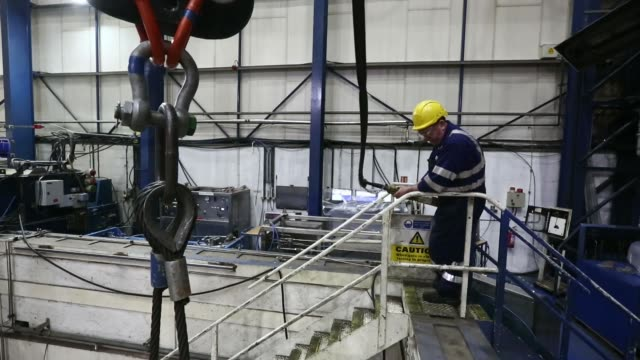 A subsea oil and gas tree is lowered into a testing pool at the General Electric Co manufacturing plant in Montrose UK on Wednesday Dec 11 A subsea...