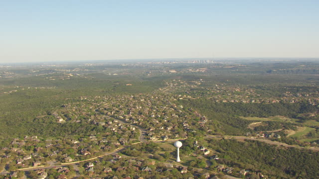 WS AERIAL suburb and downtown in far back side / Austin, Texas, United States
