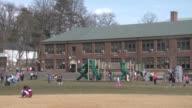 Suburban Elementary School / Exterior Elementary School / Elementary School students playing in school yard / Roosevelt Elementary School River Edge...