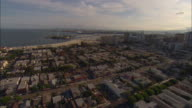 AERIAL Suburbs and beach with marina, port in distance, Long Beach, California, USA