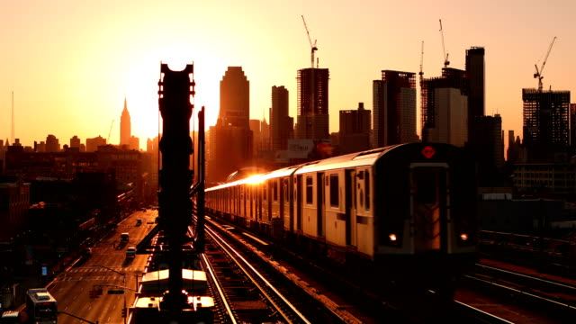 Subway Train Approaching at Sunset