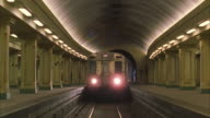 WS Subway train approaching station platform