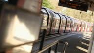 MS SELECTIVE FOCUS Subway train leaving platform at Loughton Underground Station / London, England, United Kingdom