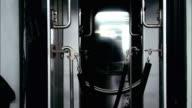 CU Subway train passing behind roped off area between subway cars / New York City, New York, USA
