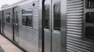 Subway train passing rail station
