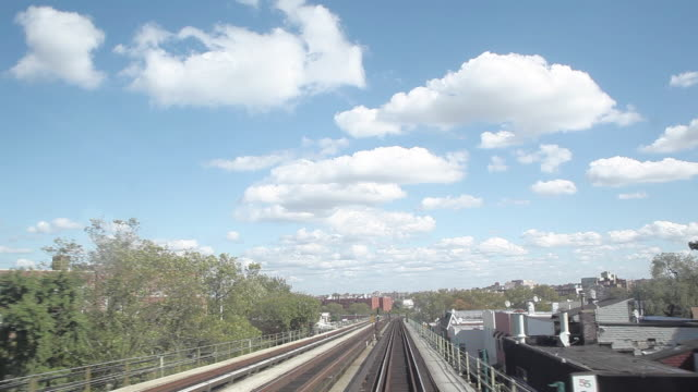 NY Subway train running on rail track out of Manhattan Tunnel