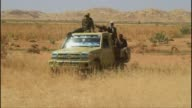 Sudanese government officials arrived in northern Darfur for a visit to probe reports that Sudanese troops carried out a mass rape in a village last...