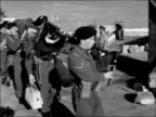 reservists leave Port Said for home EGYPT Port Said Troops towards camera with kit / MS ditto / BV on quay / MS troops towards led by piper / MS...