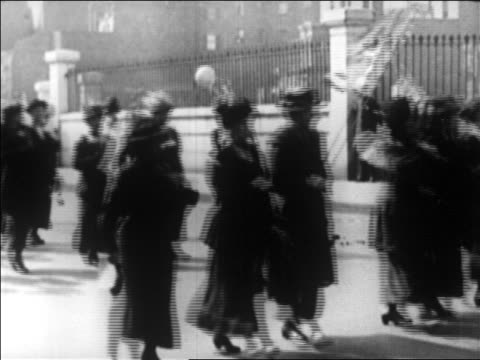B/W 1920 suffragetes with US flags marching in victory parade / Boston / newsreel