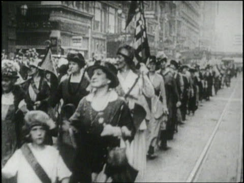 Suffragettes march in a parade for Women's Rights