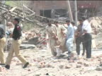 A suicide attack flattened a police building in Pakistan's city of Lahore on Wednesday killing 24 people in a bomb that the government branded...