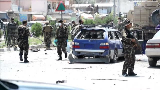 A suicide attacker targeted a NATO convoy in Kabul killing four civilians and wounding at least 35 others officials say
