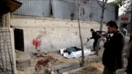 A suicide bomber blew himself up near a NATO base in Kabuls diplomatic district hitting a military vehicle and killing two people police and a...