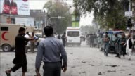 A suicide bomber killed at least 33 people and wounded 100 others in an attack Saturday outside a bank in the eastern Afghan city of Jalalabad...