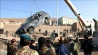 A suicide bomber kills at least six Afghan soldiers in the suburbs of Kabul the latest in a spate of Taliban attacks in the capital