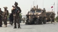 A suicide bomber targeting a NATO convoy wounded three Afghan civilians in Kabul on Sunday morning without causing casualties among Danish troops on...
