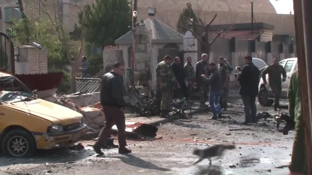 A suicide car bombing killed nine people Tuesday at a police officers club in the Syrian capital a monitor said in an attack claimed by the Islamic...