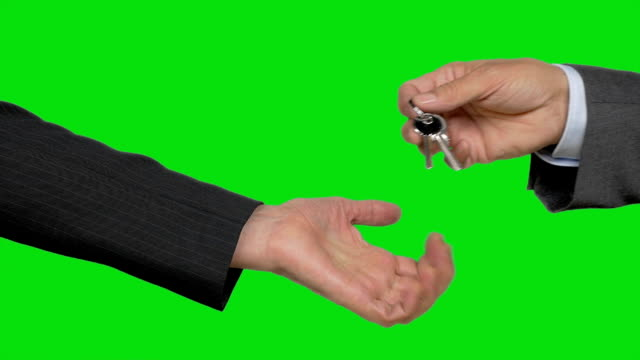 Suit man hands over key to woman who demands