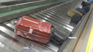 suitcases on a luggage band on the airport