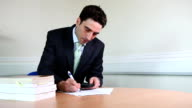 Suited male lawyer signing contracts