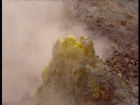 Sulphur accumulation on rock near volcanic vent, White Island, New Zealand